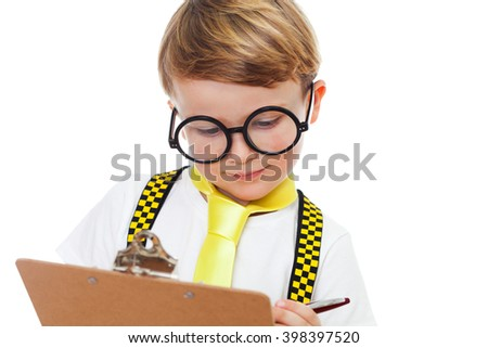 Portrait of a cute boy with glasses and clip board