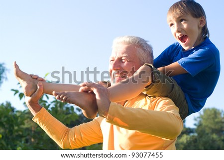 portrait of a cute boy with his grandfather