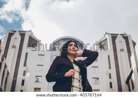Portrait of a cute business woman over business center on back - stock photo