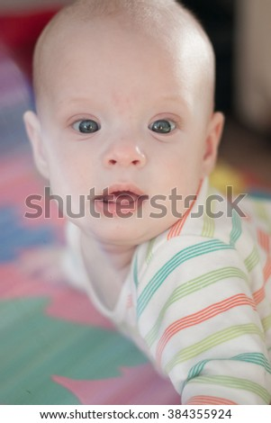 Portrait of a cute cheerful blue-eyed baby