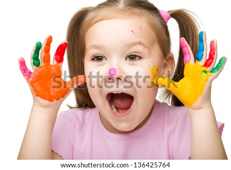Portrait of a cute cheerful girl showing her hands painted in bright colors, isolated over white - stock photo