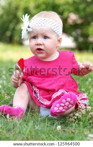 Portrait of a cute child in the park - stock photo