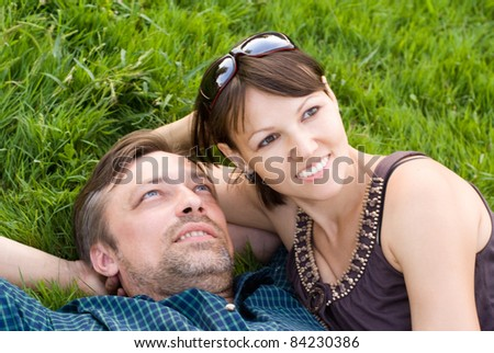 portrait of a cute couple lying on a grass