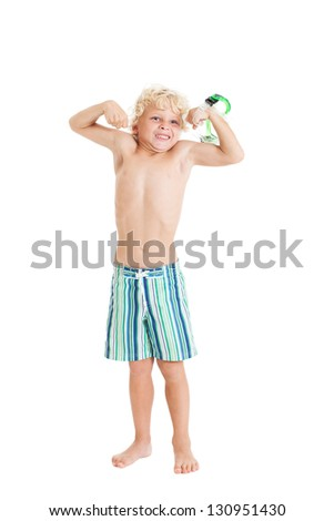 Portrait of a cute curly blond European boy in swimming shorts. A boy shows his biceps. Studio shot, isolated on white background. - stock photo