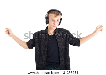 Portrait of a cute european teenage boy wearing a black shirt with headphones on his shoulders. Studio shot, isolated on white background. - stock photo