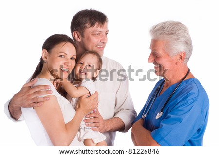 portrait of a cute family and doctor - stock photo