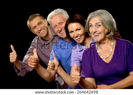 Portrait of a cute family  with senior parents - stock photo