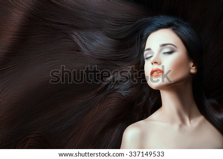 Portrait of a cute girl, and a lot of long hair. Close-up, see her perfect skin.