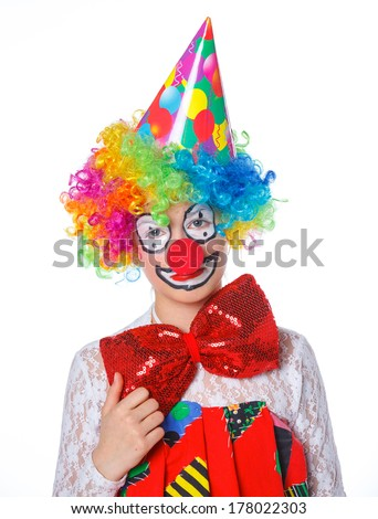 Portrait of a cute girl clown. Isolated on white background.