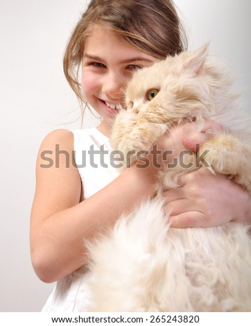 portrait of a cute girl hugging her cat - stock photo