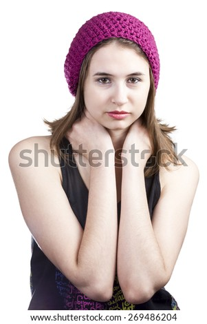 Portrait of a cute girl in a black T-shirt and crimson knitted hat isolated on a white background - stock photo