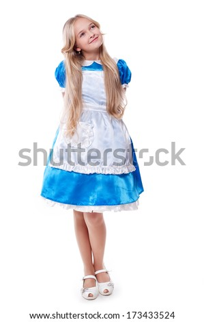 portrait of a cute girl in a blue dress and apron - stock photo