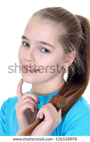 portrait of a cute girl in a blue shirt on a white background