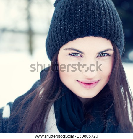 portrait of a cute girl in a hat