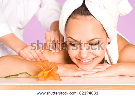 portrait of a cute girl lying at massage - stock photo