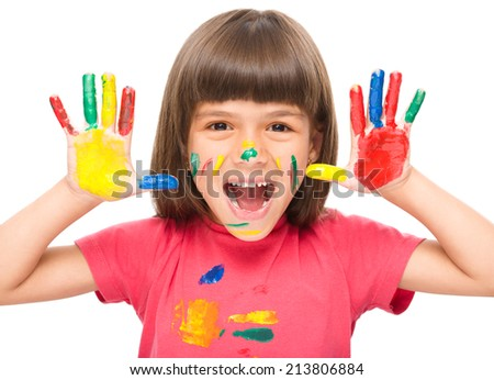 Portrait of a cute girl showing her hands painted in bright colors, isolated over white - stock photo