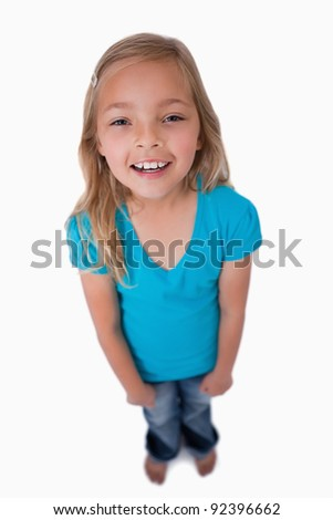 Portrait of a cute girl smiling at the camera against a white background - stock photo
