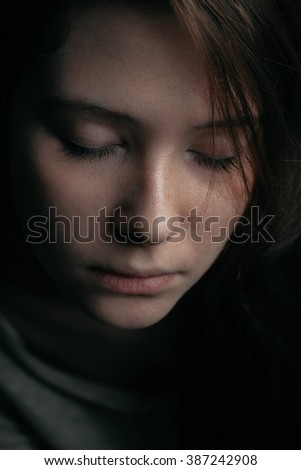 Portrait of a cute girl with closed eyes closeup. Cold shade