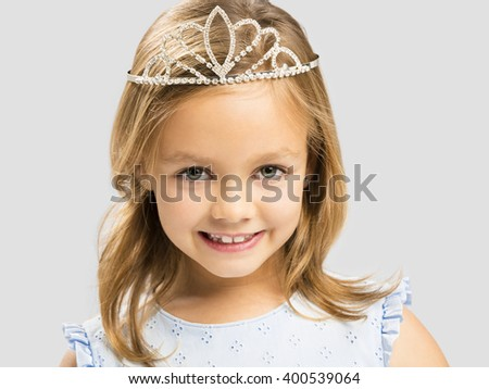 Portrait of a cute happy little girl wearing a princess crown - stock photo