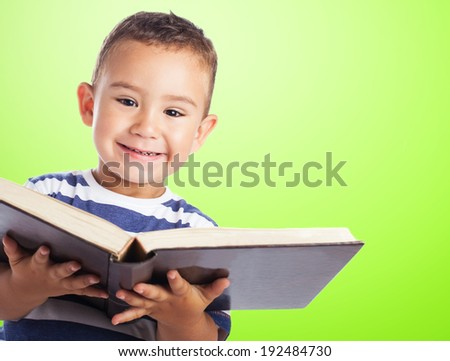 portrait of a cute kid holding a big book