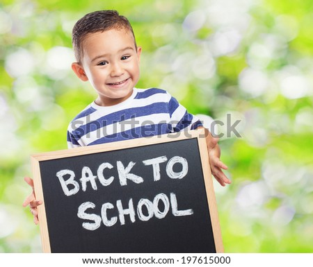 portrait of a cute kid holding a chalkboard - stock photo