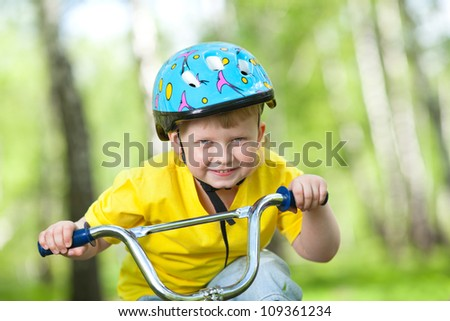 Portrait of a cute kid on bicycle - stock photo