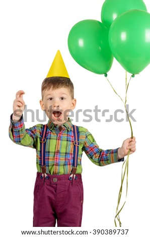 Portrait of a cute laughing little boy with birthday cap and balloons isolated on white background