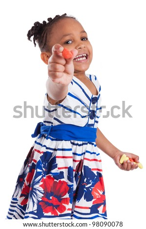 Portrait of a cute little african american girl eating candy, isolated on white background - stock photo