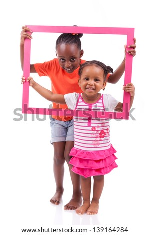 Portrait of a cute little african american girls, holding a picture frame,isolated on white background - stock photo
