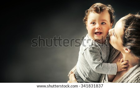 Portrait of a cute little baby with mother