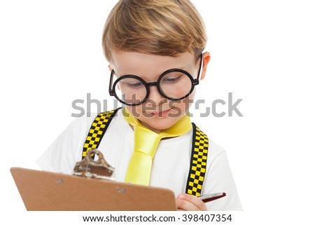 Portrait of a cute little boy in nerd glasses writing on a clip board
