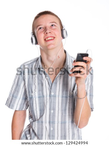 Portrait of a cute little boy listening to music on the mp3 player. Isolated white background - stock photo