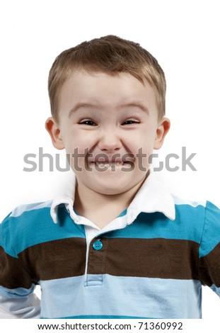Portrait of a cute little boy making faces. Isolated on white background