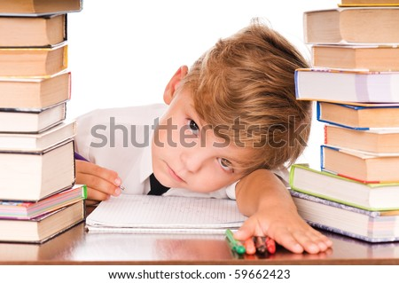 Portrait of a cute little boy sitting in library before books. Isolated over white background. - stock photo