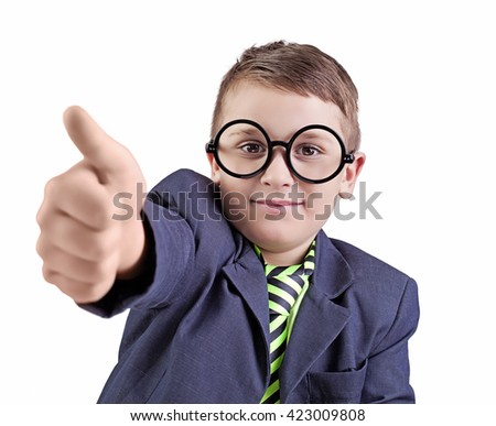 Portrait of a cute little boy, wearing funny round glasses, and checkered suspenders showing thumbs up. - stock photo