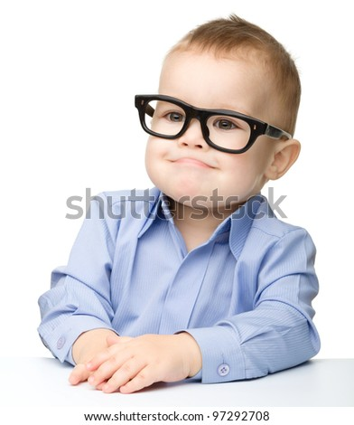 Portrait of a cute little boy wearing glasses and making funny grimace, isolated over white - stock photo