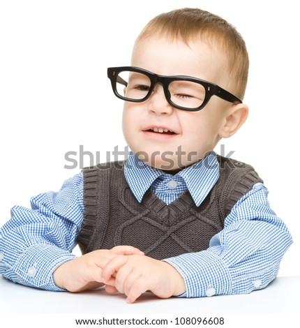 Portrait of a cute little boy wearing glasses, isolated over white - stock photo