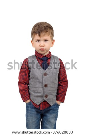 Portrait of a cute little boy wearing shirt and vest with the necktie isolated on white background - stock photo