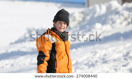 Portrait of a cute little boy with wool cap and winter jacket