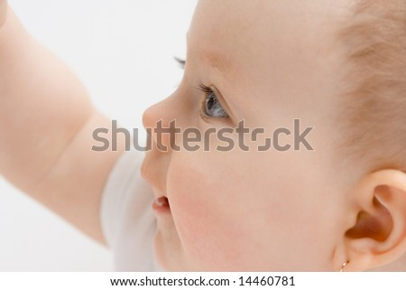 Portrait of a cute little caucasian baby girl with excited facial expression - stock photo