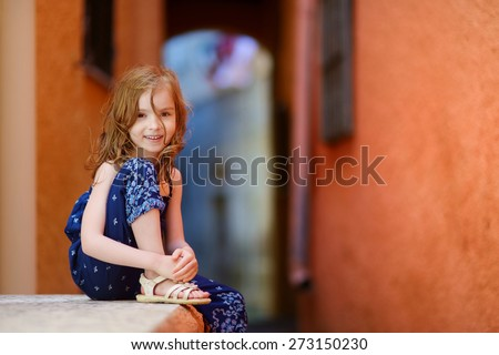 Portrait of a cute little girl at summer - stock photo