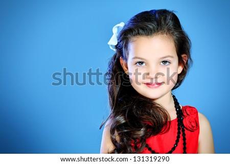 Portrait of a cute little girl in a beautiful dress. - stock photo