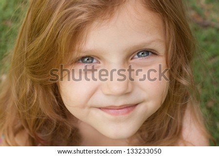 portrait of a cute little girl outdoors