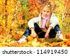 Portrait of a cute little girl posing at the autumn park. - stock photo