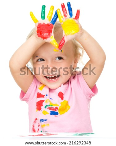 Portrait of a cute little girl showing her hands painted in bright colors, isolated over white - stock photo