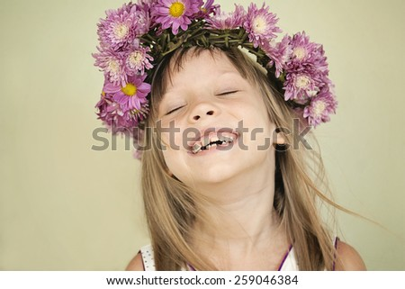 Portrait of a cute little girl with flowers