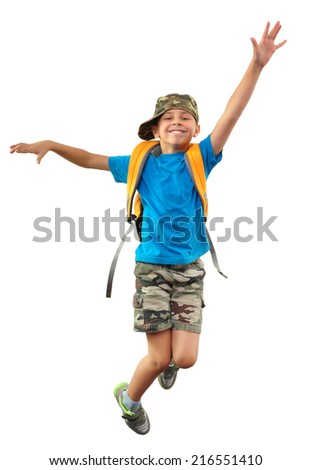 Portrait of a cute little schoolchild with backpack and a cap jumping. Isolated over white background. - stock photo