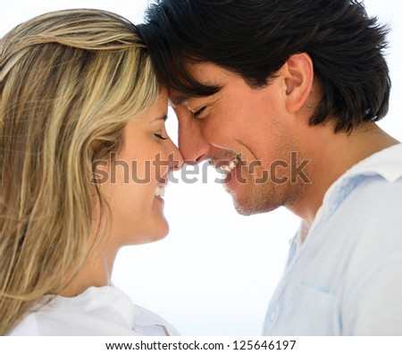 Portrait of a cute loving couple looking happy
