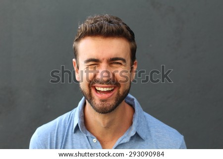 Portrait of a cute man winking