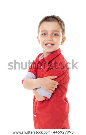 Portrait of a cute modern boy with arms folded over white background